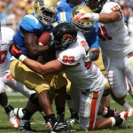 Oregon State defensive lineman Mana Rosa (93) tackles UCLA running back Johnathan Franklin at the Rose Bowl in a game played earlier this year. Photo by Stephen Dunn/Getty Images North America.