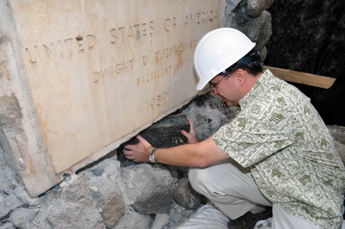 Managing Director Keith Regan removing the time capsule below the cornerstone.