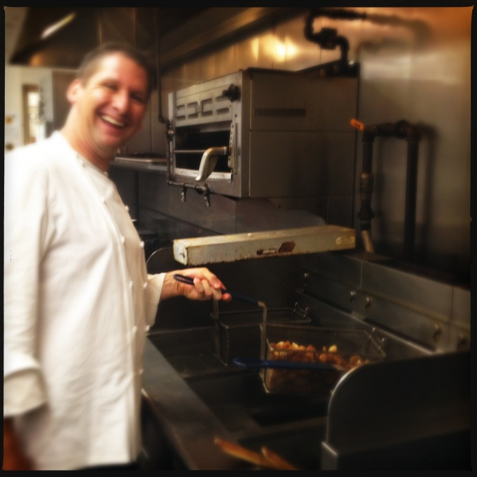 Executive Chef Marc McDowell cheerfully agrees to relive his days as a fry boy for a photo op. Photo by Vanessa Wolf