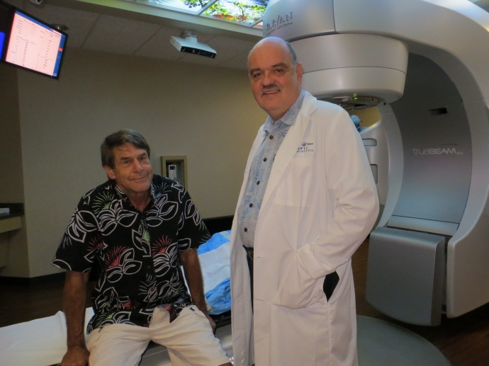 Dr. Bobby Baker, president and founder of the Pacific Cancer Instituteof Maui, talks Friday to Kihei patient Greg Benson (left) as he preparesto receive a new treatment called Stereotactic Body Radiation Therapy.Benson is one of the first three patients on Maui to receive the treatment fora moving tumor in his lung.