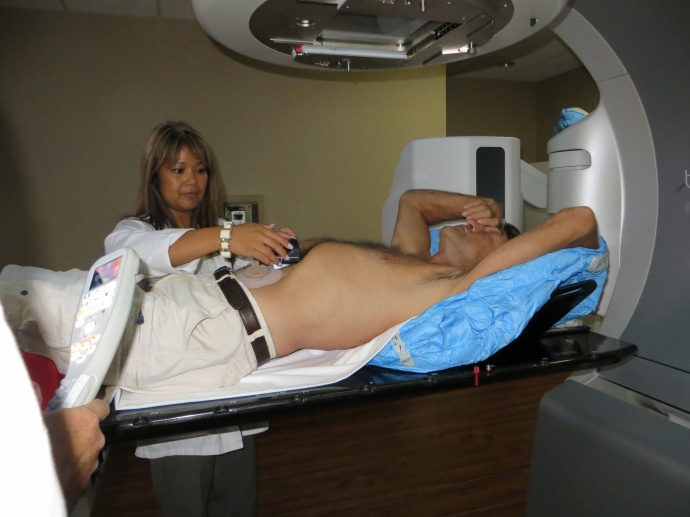 Radiation therapist Nerissa Catbagan prepares patient Greg Benson, 65,of Kihei, for Stereotactic Body Radiation Therapy on Friday afternoon atthe Pacific Cancer Institute of Maui. This was Benson's fourth and finaltreatment this month for a moving tumor in his lung. The Pacific CancerInstitute reached a milestone in January when it began offering StereotacticBody Radiation Therapy for its patients.