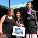 Maui High School Student and Family Sundays MacBook Pro Winner Giel Tolentino with nominating teacher Jennifer Suzuki and Elyse Ditzel of Whole Foods Market, an education sponsor of Family Sundays. Courtesy photo.