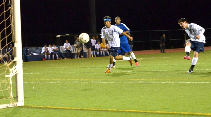 Kamehameha Maui's Chandler Alo scores against Maui High on this goal right before halftime Tuesday at Kanaiaupuni Stadium. Photo by Rodney S. Yap.