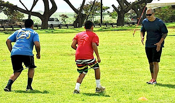 Kaluka Maiava works with a pair of Maui athletes at last year's HardNaks High-Performance Speed Camp. File football by Rodney S. Yap.