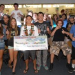 Students at Kaiser High School celebrate Aaron Nee's (center with check) win. Courtesy photo.