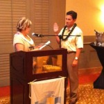 Anna Rodriguez, the IEHA director-at-large swears in David Crouch, the director of housekeeping at the Four Seasons Maui Resort at Wailea at September. Photo courtesy of Kevin Curry.