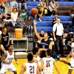 King Kekaulike point guard Jansen Agapay drives to the basket en route to a 3-point play late in the game Thursday night against Baldwin. Photo by Rodney S. Yap.
