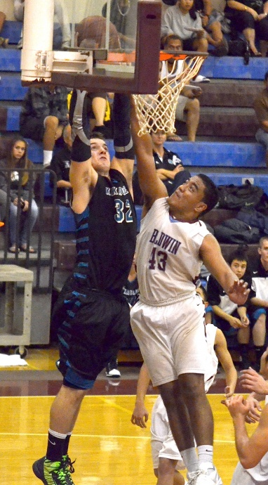 Baldwin's Teva Eldredge (43) battles King Kekaulike's Jacob Havron under the basket Tuesday night at Baldwin gym. Na Alii clinched the 2013 MIL boys Division I championship with a 42-36 triumph. Photo by Rodney S. Yap.