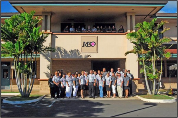 Staff stand outside the MEO building in Wailuku. Courtesy file photo.