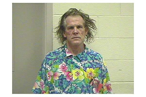 To the best of our knowledge Nick Nolte has never crashed through the ceiling of a police station, but we envision a similar photo might that ever occur.