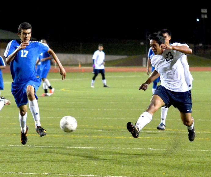 Kamehameha Maui senior Taylor Kaaukai (23) just missed scoring on this attempt midway through the second half Tuesday against Maui High. Photo by Rodney S. Yap.