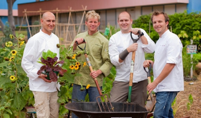 L to R: Four Seasons Ferraro's Chef de Cuisine Nicholas Porreca, Private Maui Chef Owner/Chef Dan Fiske, Spago Chef Cameron Lewark, and Capische?/Il Teatro Chef de Cuisine Christopher Kulis gather at the Kihei Elementary School garden. Photo courtesy Jess Craven.