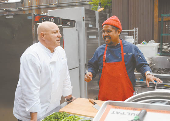 Chefs Colicchio and Simeon. Alas, the red hat is no more. Photo courtesy Bravo TV.