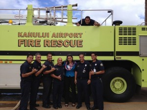 Rep. Tulsi Gabbard with firefighters from the Kahului Airport Fire Rescue. Courtesy photo.