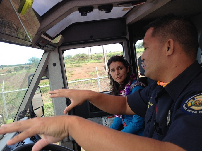 Rep. Tulsi Gabbard takes a tour of the Kahului Airport runway with members of the Kahului Airport Fire Rescue and receives a firetruck demonstration.  Courtesy photo.
