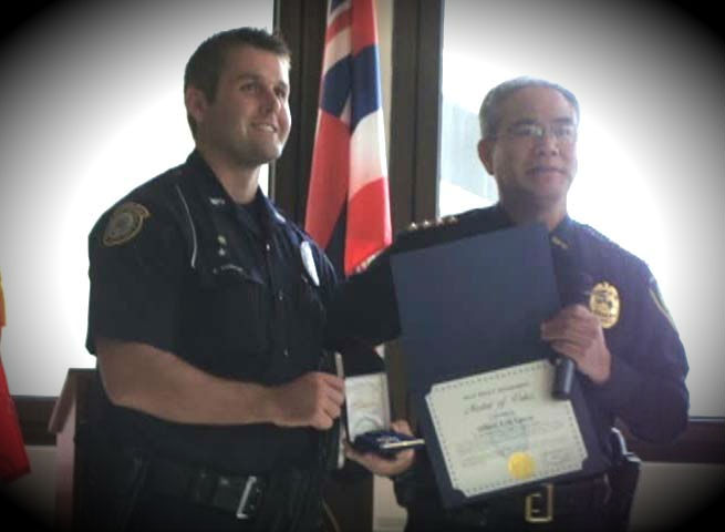 Maui Police award ceremony, Friday, Feb. 22, 2013. Pictured left is Silver Medal of Valor recipient, Erik Losvar with Maui Police Chief Gary Yabuta (right). Photo by Wendy Osher.