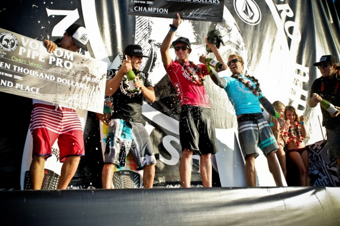 Hawaii's John John Florence (red) celebrates winning his third consecutive Volcom Pipe Pro Saturday at Banzai Pipeline. Hana's Ola Eleogram (black) prepares the champagne for Florence. The Maui surfer finished fourth in the finals worth $5,500. Photo by Tom Carey / VolcomPipePro.com.