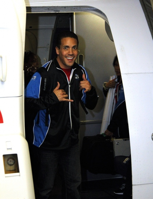 Hawaii All-Star Cheerleaders founder and head coach Kealii Molina steps off the plane first with a championship smile of course. Photo by Ben Juan.