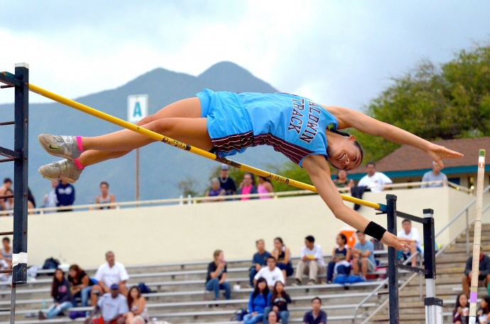 Baldwin's Amber Kozaki clears the pole vault bar at 12 feet, 1 inch, breaking her own meet record of 12-0 at Friday's Yamamoto Invitational track meet. Photo by Rodney S. Yap.