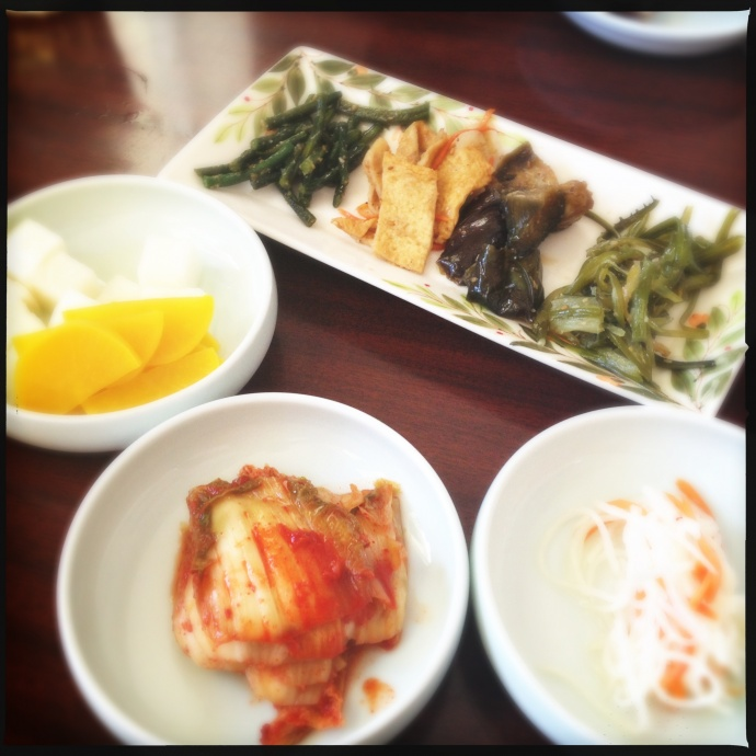The complementary banchan includes some badass kimchee. Photo by Vanessa Wolf