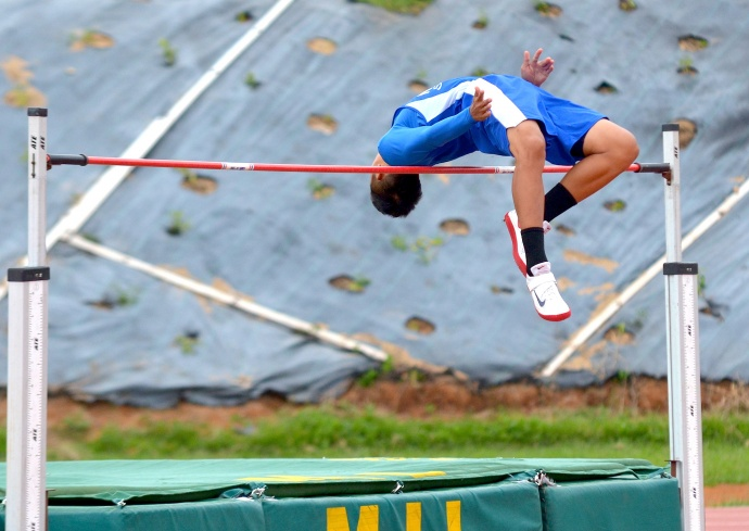 Maui High School's Vincent  Keomoungkhoune won the boys high jump Friday with fewer misses at 5 feet, 11 inches. Photo by Rodney S. Yap.