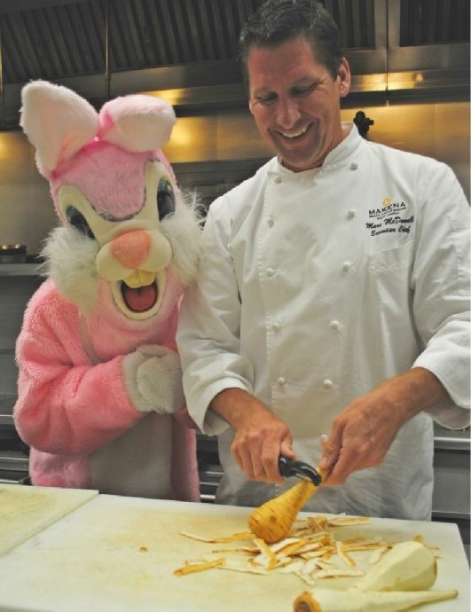 Makena Beach and Golf Resort's Executive Chef Marc McDowell's eyes belie fear as he attempts to remain calm and continue cooking  next to that freaky pink bunny. Courtesy photo.