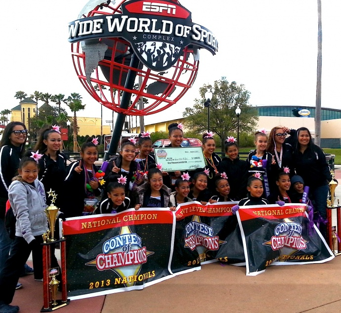 Cheerleaders and coaches of the Warrior Elite All-Stars Cheerleading Club's Youth Level 1 (ages 8-12) and Junior Level 2 Division (9-14) pose after winning the Contest of Champions 2013 Nationals competition, March 3, in Orlando, Fla. Photo by Warrior Elite All-Stars Cheerleading Club.