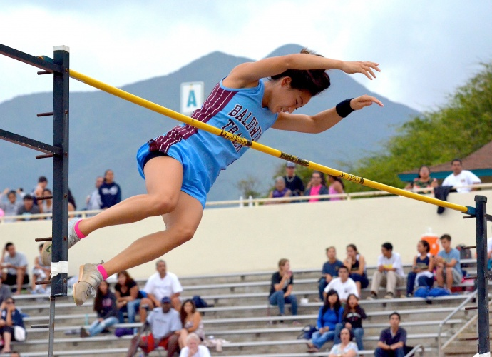 Baldwin's Amber Kozaki looks down at the pole vault pit below her after clearing 12 feet, 1 inch Friday. Photo by Rodney S. Yap.