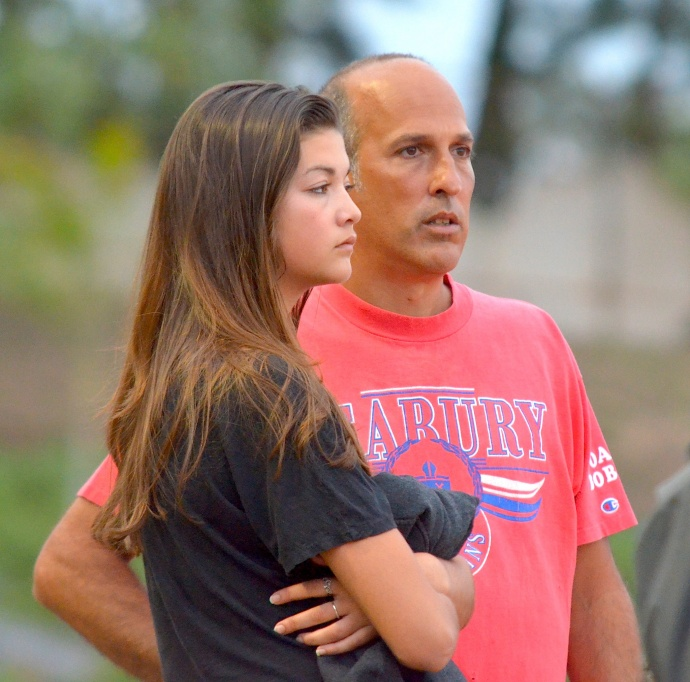 Seabury Hall head coach Bobby Grossman got a surprise visit from his daughter Haley at Friday's trials of the Yamamoto Invitational. Photo by Rodney S. Yap.