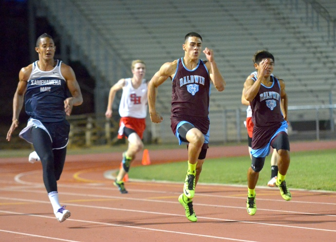 Baldwin High's Keelan Ewaliko leads teammate Aaron Marzan (right) and Kamehameha Maui's Jamal Jones in the boys 200-meter dash. Ewaliko won the race, followed by Jones and Marzan — all clocking personal best times. Photo by Rodney S. Yap.