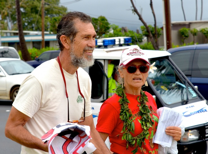Walter Ritte (left) at Maui rally against GMOs. Photo by Rodney Yap.