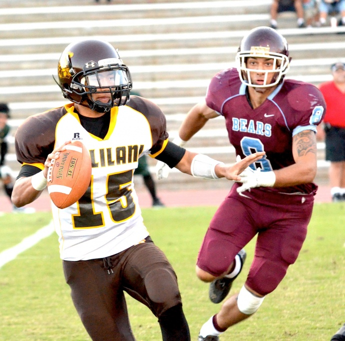 Baldwin High School's Jordan Hoiem (8) pressure's Mililani quarterback Jarin Morikawa (15) during the state football playoffs here in November. File photo by Rodney S. Yap.