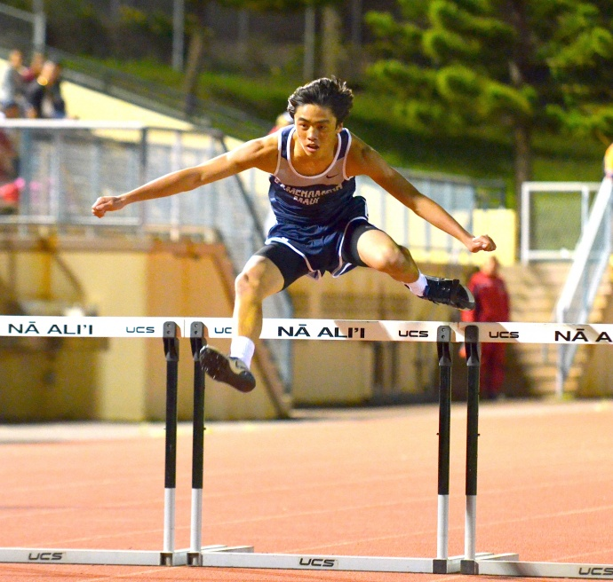 Kamehameha Maui sophomore Jesse Amaral shows his winning form in the junior varsity boys 300 hurdles. Photo by Rodney S. Yap.