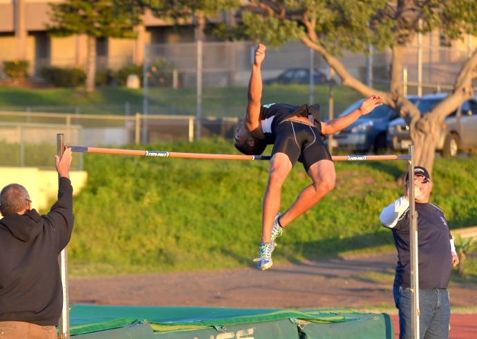 King Kekaulike high jumper Jordan Romero en route to a winning 6-foot jump in the boys high jump Friday. Photo by Rodney S. Yap.