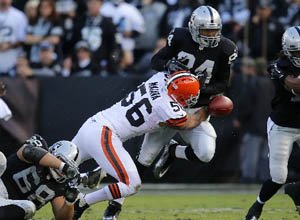 Former Cleveland linebacker Kaluka Maiava (56) is shown tackling the Raiders' Juron Criner in the second quarter in Oakland, Calif., on Sunday, Dec. 2, 2012. Photo by Nhat V. Meyer.