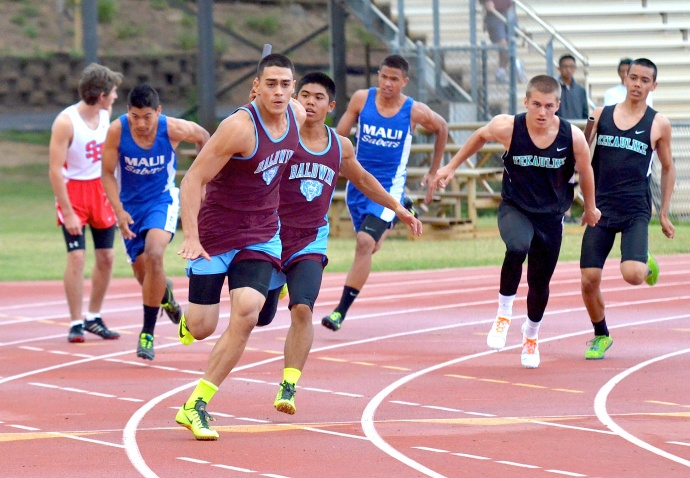 Baldwin's Keelan Ewaliko gets the baton from Aaron Marzan in the last exchange of the boys 400-meter relay. Photo by Rodney S. Yap.