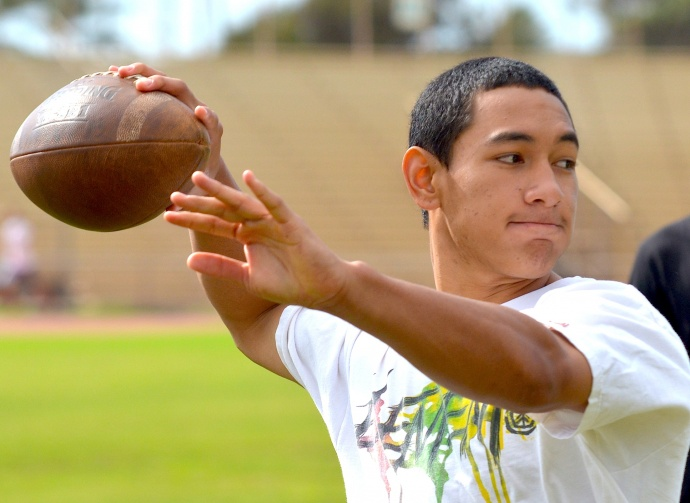 "Lahainaluna quarterback Sione Makoa Filikitonga throws a pass Saturday at the ""Quarterback / Receiver Clinic."" Photo by Rodney S. Yap."