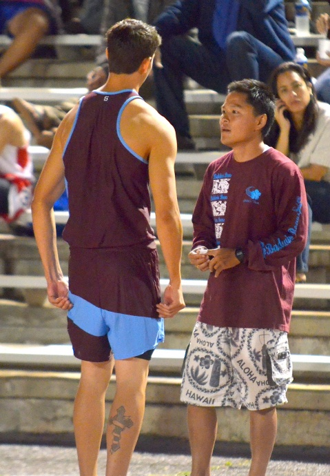 Baldwin's Tyler Feiteira talks with pole vault coach Linden Wada after missing his first attempt at 13 feet, 6 inches Friday. Photo by Rodney S. Yap.