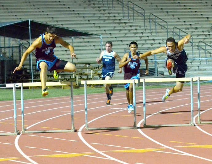 Baldwin's Tyler Feiteira (left) defeated Kamehameha Maui's Connor Kala'i Yap (right) in the boys 300-meter Intermediate hurdles Friday at the Satoki Yamamoto Track & Field Facility. Photo by Rodney S. Yap.