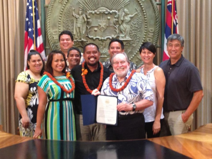 Chef Sheldon Simeon receives the governor's commendation at the state building. Courtesy photo.