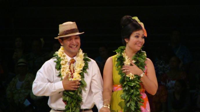 Nā kumu hula 'Iliahi and Haunani Paredes of Hālau Kekuaokalā'au'ala'iliahi, accept honors at the 50th edition of the Merrie Monarch hula festival. Photo by Wendy Osher.