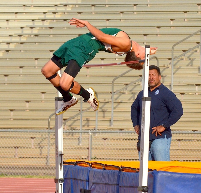 Maui Prep Academy's Troy Otto wins the high jump Friday with a season best 6 foot, 4 inches. Photo by Rodney S. Yap.