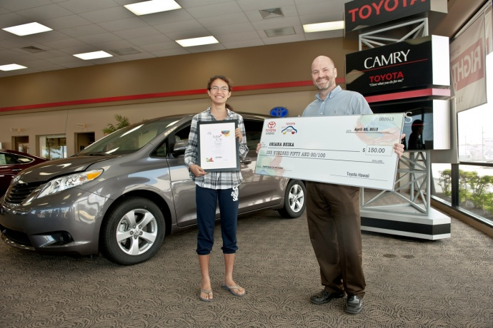 FINALIST: Oriana Buika, age 14, H.P. Baldwin High School receives $150 check from Toyota Hawaii' David Whitney. Courtesy photo.