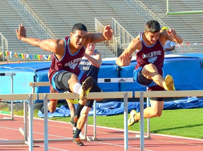 Baldwin's Abraham Reinhardt battles teammate Tyler Feiteira in the boys 110-meter high hurdles. Photo by Rodney S. Yap.