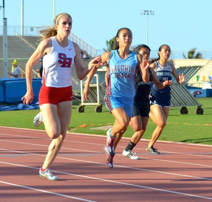 Seabury Hall's Alyssa Bettendorf holds off Baldwin's Amber Kozaki in the girls 100-meter dash on Saturday. Photo by Rodney S. Yap.