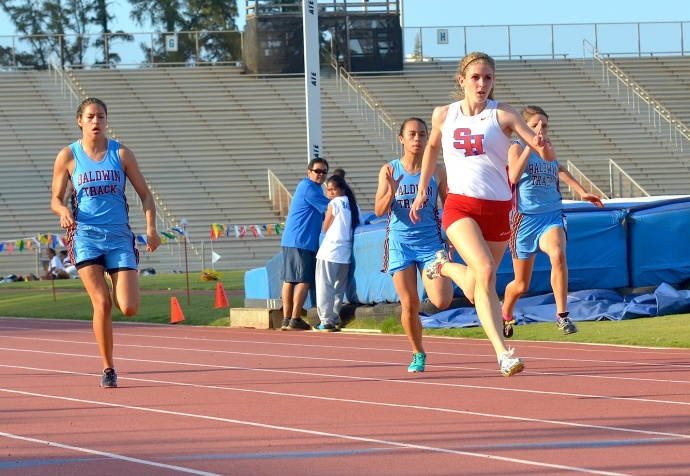 Seabury Hall's Alyssa Bettendorf races to the 100 finish en route to the girls Most Outstanding Track Athlete award for winning the 100, 200 and 400 meter dashes. Photo by Rodney S. Yap.