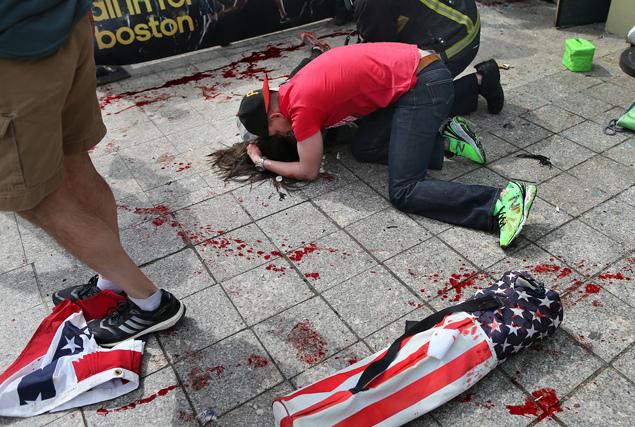 A scene from the Boston Marathon explosion. Photo courtesy of ASI Times.