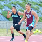 King Kekaulike's Jay Braun pushes Baldwin's Keelan Ewaliko in a dead-even battle of the 400-meter relay. Photo by Rodney S. Yap.