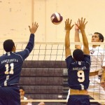 Baldwin's Bradley Bowlin rips a kill through the block of Kamehameha Maui's Kolby Ah Sau (11) and Manaloa Aikala (9). Photo by Rodney S. Yap.