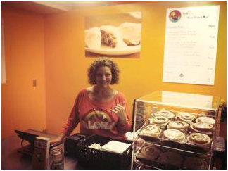 Victoria Briggs, owner of No Ka 'Oi Cinnamon rolls at Whalers Village on store on opening day.Courtesy photo.